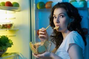 hungry-woman-at-fridge-nighttime-snack